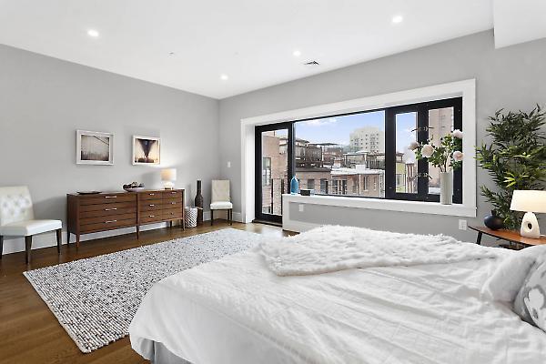 master bedroom with balcony door