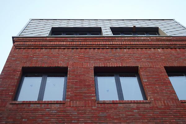brick cornice and metal siding detail