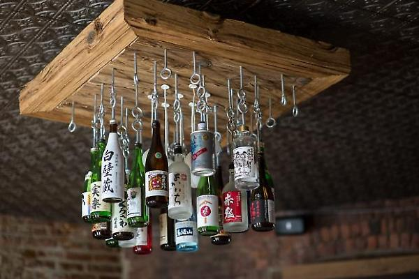 sake bottle chandelier by day