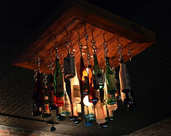 sake bottle chandelier by night