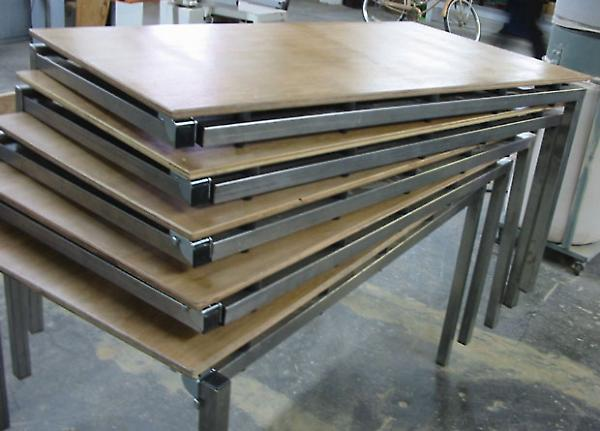 stacked tables with corner leg in upright position
