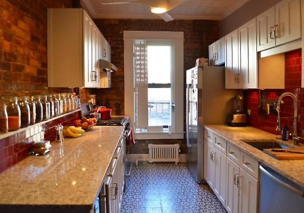 view of kitchen with exposed brick walls