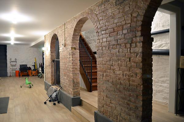 finished cellar with exposed brick arches