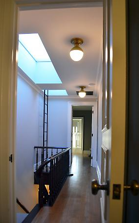upper hallway with skylights